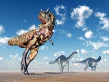 Carnotaurus och Apatosaurus Fotografering för Bildbyråer