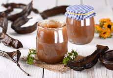 Carob jam in jar Royalty Free Stock Photo