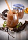 Carob jam in jar Stock Image