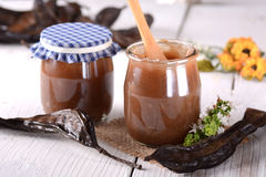 Carob jam in jar Royalty Free Stock Photography