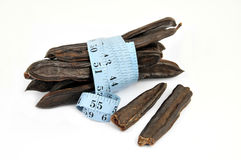 Carob and measure isolated Royalty Free Stock Images