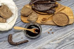 Carob pods and products made of it stock photography