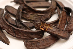 Carob pods and seeds Stock Images