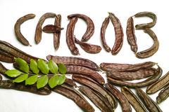 Carob written with pods Stock Photo