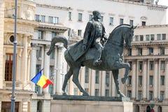 Carol I of Romania. Statue in Bucharest, Carol I of Romania, flag of Romania hoisted Royalty Free Stock Image