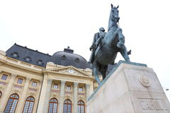 Carol I statue. Statue Carol I of Romania on horseback and Central University Library in background Royalty Free Stock Photos