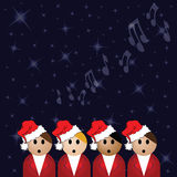 Carol singers. Christmas carol singers against a star covered night sky Royalty Free Stock Images