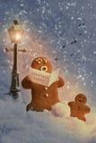 Carol Singers. Gingerbread men carol singers at Christmas Stock Images