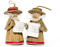 Carol Singers with Sheet Music. Christmas carol singer decorations made from wood, wicker and straw Royalty Free Stock Photos