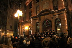 Carolers and bystanders enjoying the night, Victorian Street Walk,Saratoga,New York,2015 Royalty Free Stock Images