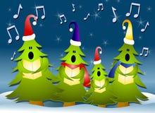 Carolers del árbol de navidad que cantan en nieve Foto de archivo
