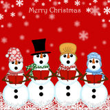 Carolers del muñeco de nieve de la Navidad que cantan rojo Fotos de archivo
