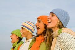 Carolers do Natal, juventude do grupo fotografia de stock royalty free