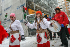 Carolers dressed in national costumes Royalty Free Stock Photo