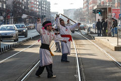 Carolers playing on streets Stock Photos