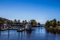 Carolina Beach State Park Marina on the South end of Snows Cut in North Carolina. Blue Sky, Boats, Trees royalty free stock photos