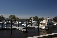 Carolina Beach State Park Marina on the South end of Snows Cut in North Carolina. Blue Sky, Boats, Trees stock image