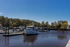 Carolina Beach State Park Marina on the South end of Snows Cut in North Carolina. Blue Sky, Boats, Trees stock photo