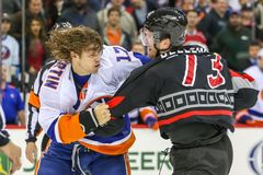 Carolina Hurricanes defenseman Brett Bellemore and New York Islanders left wing Matt Martin Royalty Free Stock Images