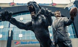 North Carolina Panthers football panther statue roaring fierce. Carolina Panthers black cat statue roaring and baring teeth in front of football stadium royalty free stock photo