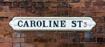 Caroline Street British Vintage Street Signs against Red Brick W Stock Images