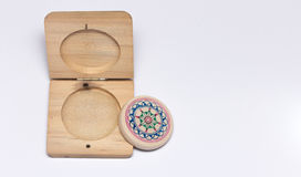Carom striker with wood case. A closeup image carom striker and wood case on the white background stock image