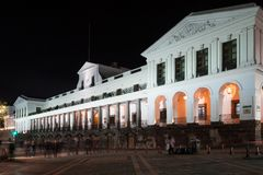 Carondelet Palace, Old Quito, Ecuador. Night view of Carondelet Palace; motion blur of walking people. It is the seat of the government of the Republic of Royalty Free Stock Photography