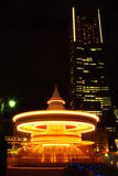 Carosello alla notte nell'esposizione lunga Fotografia Stock Libera da Diritti