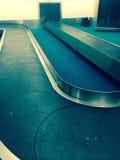 Carosello di bagagli dell'aeroporto Fotografia Stock Libera da Diritti