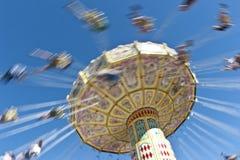 Carosello di filatura d'accelerazione all'esposizione Fotografie Stock
