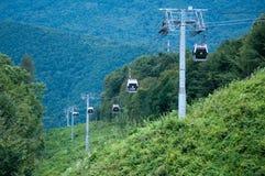 Carosello Soci della montagna della teleferica Fotografia Stock