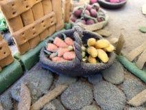 Sugar past figure. Marzipan vagetable. Carot, banana, basket Stock Images