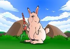 Carota della tenuta del coniglio sulla natura Fotografia Stock