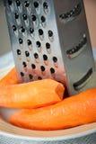 Carota e grattugia per le verdure Immagine Stock Libera da Diritti