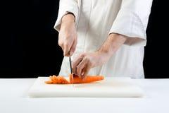 Carote di taglio del cuoco unico fotografia stock libera da diritti