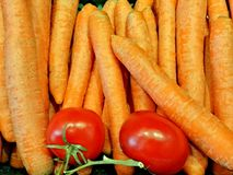 Caroten en tomaten Stock Afbeelding