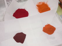Carotenoid pigments. Four different carotenoids pigments on white paper: Lutein, Zeaxanthin,Astaxanthin and Canthaxanthin Royalty Free Stock Photos