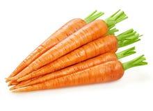 Carottes fraîches de carottes d'isolement Photo stock