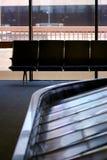 Carousal del bagaglio con le sedi Fotografie Stock