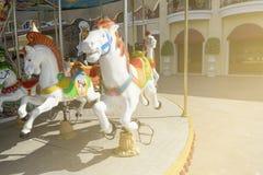Carousel в городе с солнечным светом Стоковая Фотография