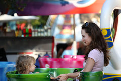 Carousel. Woman with child on carousel stock photo