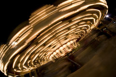 Carousel. Blurry / long exposure image of a brightly lit Carousel ride Royalty Free Stock Images