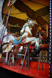 Carousel. Merry-go-round in a carnival Stock Photos