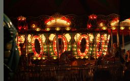 Carousel. At a fair at night lit up royalty free stock photography