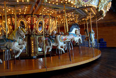 Carousel. An indoor carousel at an amusement park Stock Images
