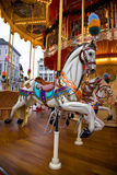 Carousel. A white horse on a colourful merry-go-round royalty free stock images