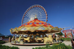 Carousel at amusement park Stock Images