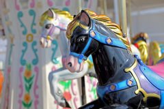 Carousel in an Amusement Park. Colorful Carousel in an Amusement Park with Horses Stock Photo
