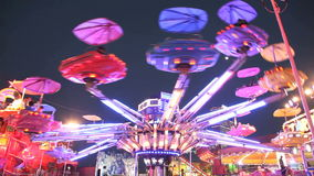 Carousel in amusement park at night stock video footage