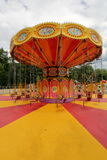 Carousel at amusement park. Orange carousel in an empty amusement park in late summer Royalty Free Stock Photos